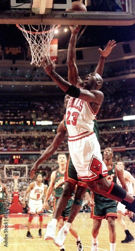 528e9cc9c6 Chicago Bulls guard Michael Jordan goes to the air to score against the  Seattle SuperSonics in