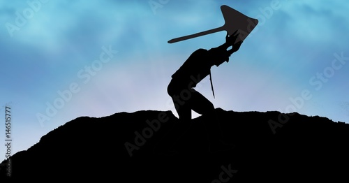 Fototapety, obrazy: Silhouette businessman lifting arrow sign o mountain against sky