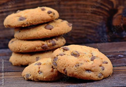 Tuinposter Koekjes Chocolate chip cookies on wooden background