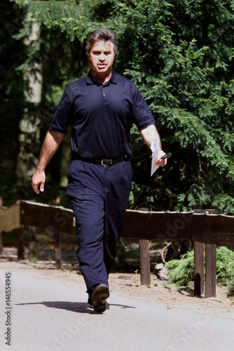 Dutch Soccer Coach Guus Hiddink Walks To A News Conference At The National Associations Trai