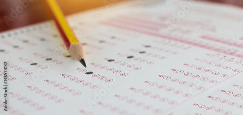 Fotografía  Standardized test exams form with answers bubbled in and color pencil resting on