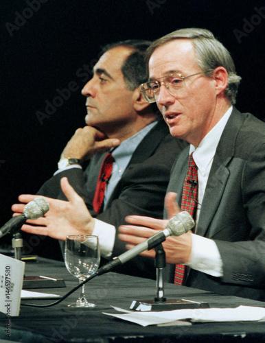 John J  Mack (L), president of Morgan Stanley, listens as Philip J