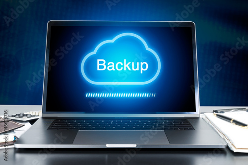 Photo modern laptop on work desk with Cloud Backup concept