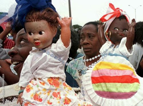 Followers of the Afro-cuban religion Santeria hold aloft