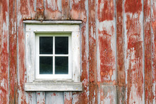 Weathered Red Barn Siding And Window Of Upstate New York Catskill Mountains Barn. Rough Condition With Cracks And Peeling Paint.