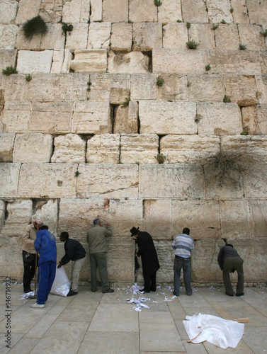 Workers remove notes from cracks in the Western Wall in