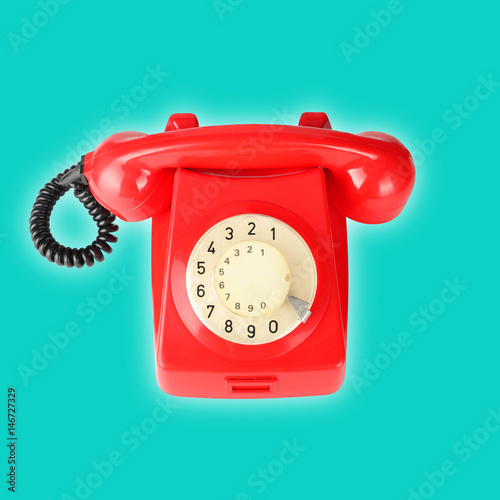 red-vintage-phone-on-a-blue-ba