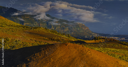 The hillside of the teide volcano lit by the setting sun, down the ocean and flowing sea of clouds #146727983