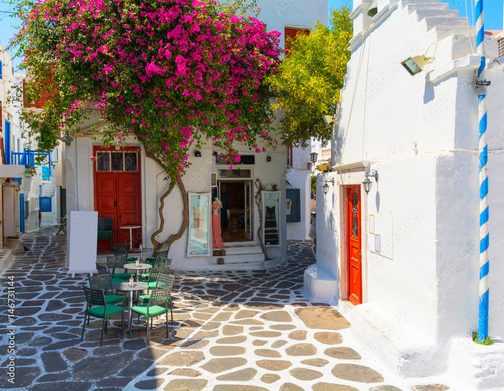 whitewashed narrow street in Mykonos island, Cyclades, Greece