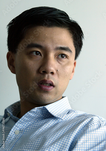 Bo Shao, Chairman and CEO of eBay EachNet, answers a question in