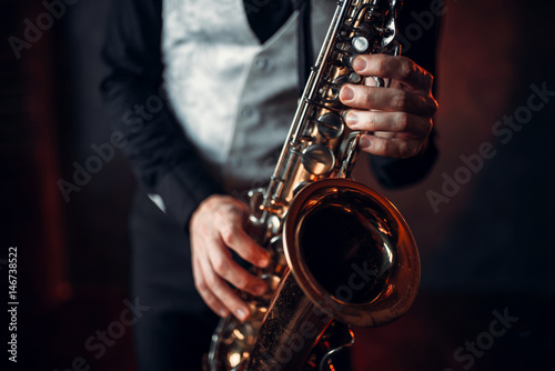 Jazz man hands holding saxophone closeup Canvas Print