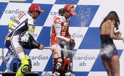 Yamaha s Rossi and Honda s Elias spray a hostess with champagne during the  award ceremony of the Czech Republic Grand Prix at the Masaryk circuit in  Brno 022cd26ec693