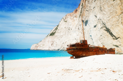Photo Stands Shipwreck Navagio Shipwreak beach of Zakinthos island, Greecer, retro toned