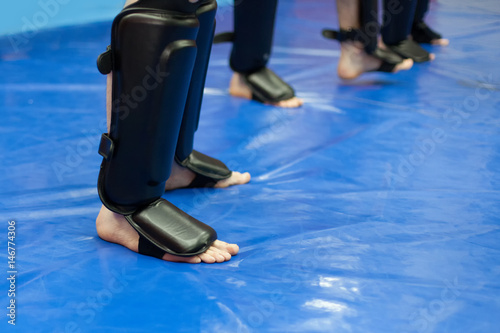 Poster Vechtsport protective leg gear for mixed martial arts