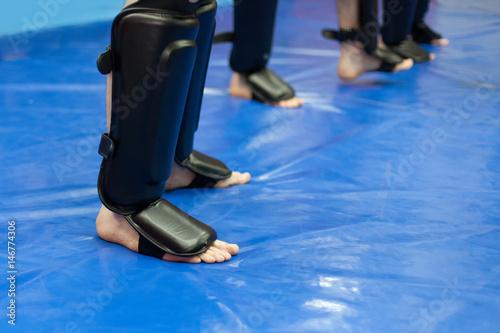 Foto op Plexiglas Vechtsport protective leg gear for mixed martial arts