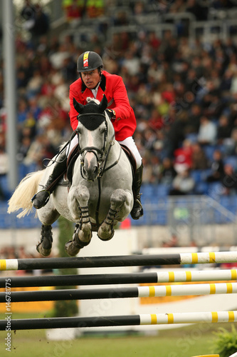 Belgium's Ludo Philippaerts clears a jump on Parco during