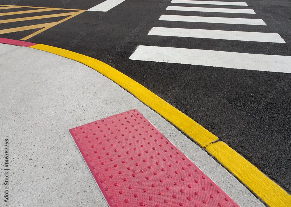 Fototapeta painted curb and crosswalk markings