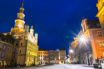 Beautifully illuminated Poznan's  Old Town with  historic city hall.