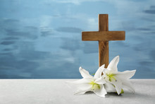 Wooden Cross And White Lily On Table