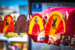 Leinwanddruck Bild - Colorful Spanish Fans arranged for sale in a store
