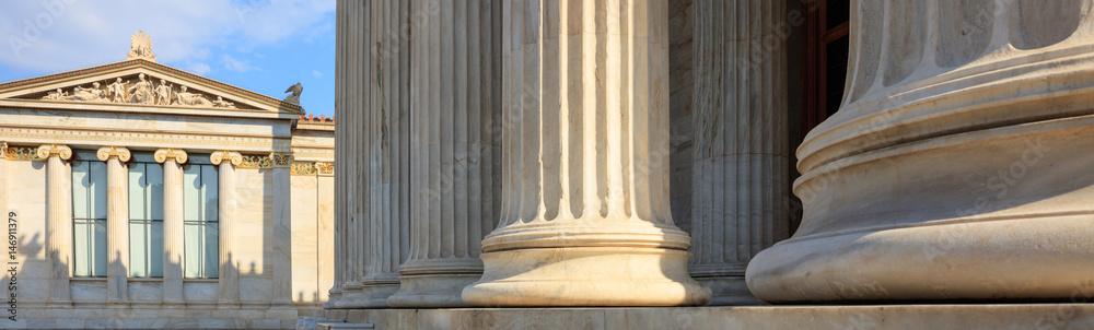 Fototapeta Greek marble pillars infront of a classical building