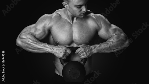 Black And White Photo Of Shirtless Young Athlete With Muscular Body Exercising Crossfit Kettle Bell