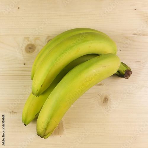Fototapeta Bananas isolated on wooden background - top view obraz na płótnie