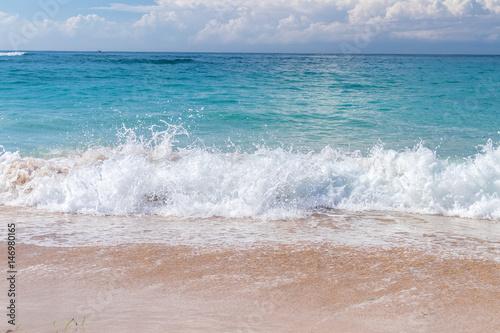 Aluminium Prints Beach Ocean waves on a tropical beach of magic Bali island, Indonesia.
