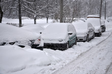 Winter Scene. Snow-covered Cars In The Yard.