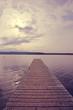 Bridge on the lake. Wooden plank lake pier. bridge on the lake on sky background