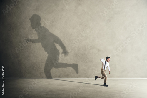 Photo  man and his shadows running in different direction