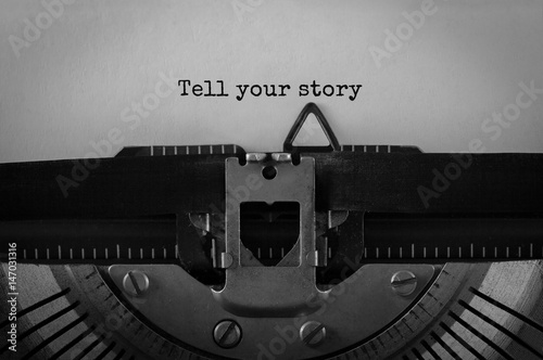 Fotografie, Obraz  Text Tell Your Story typed on retro typewriter
