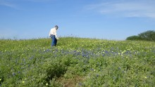 A Photographer Scoping Out The Best Place To Take Photographs In The Southeast Texas Bluebonnets.