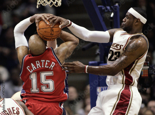 cbba626dd2f Cleveland Cavaliers LeBron James blocks the shot of New Jersey Nets Vince  Carter during NBA game