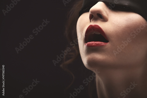 Fotografie, Obraz  Beautiful brunette Woman with Black Lace mask over her Eyes