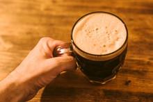 Man Drinking Dark Beer In British Dimpled Glass Pint Mug