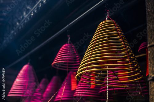 Burning incense coils Poster