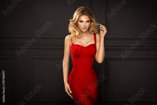 Slika na platnu Sensual beautiful blonde woman posing in red dress