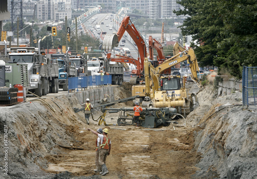 Workers dig trench for rapid transit line in Vancouver - Buy