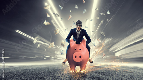 Fototapeta Young businesswoman riding on piggy bank, isolated on white. Saving concept obraz