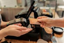 Customer Buying Food In Shop