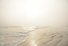 Beautiful Foggy Beach At Sunrise. Sun Reflected On The Beach. Daytona Beach, Florida, USA.