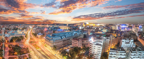 Panorama of traffic lights in the center of the capital city of Romania. Center of Bucharest at sunset. Romanian Parliament and University square.