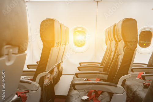 Empty Seats In Economy Class Passenger Section Of Airplane Near