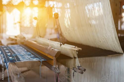 Fotografie, Obraz  weave silk cotton on the manual wood loom,vintage color