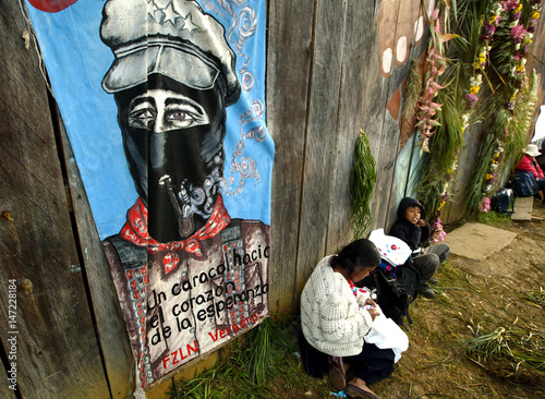 Mexican Indians Rest In Front A Mural Of Commander Marcos Buy