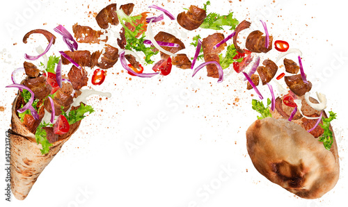 Kebab sandwich with flying ingredients.