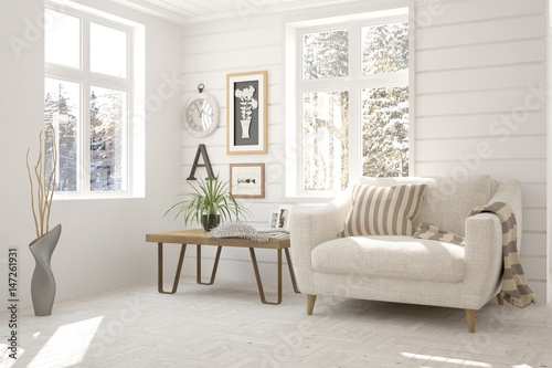Vászonkép  White room with armchair and winter landscape in window