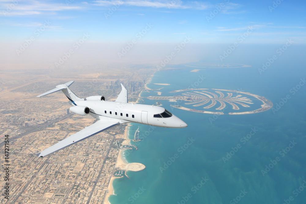 Fototapety, obrazy: Business jet airplane flying over Dubai city and sea coastline.