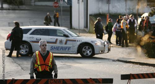 Sherriffs block roads for arrival of accused serial killer